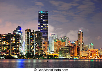 Miami urban architecture closeup over sea at night.