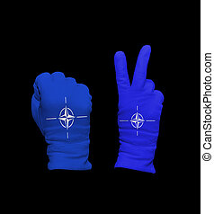 NATO flag - Clenched fist in leather glove, and hand with...
