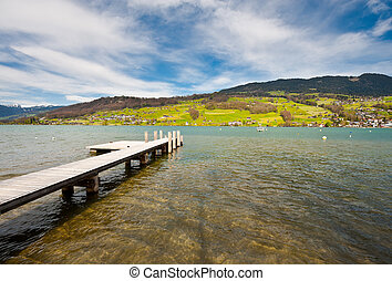 Gangway - Lake Sarner on the Background of Snow-capped Alps,...