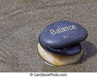 3 stones one etched with balance - Three stones stacked upon...