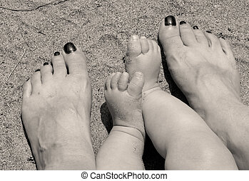 mom and baby feet together - a black and white rendered...