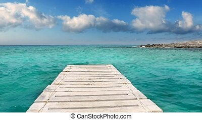 beach wooden pier turquoise sea Formentera Balearic islands...