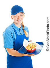 Teenage Fast Food Worker - Teenage worker serving a fast...