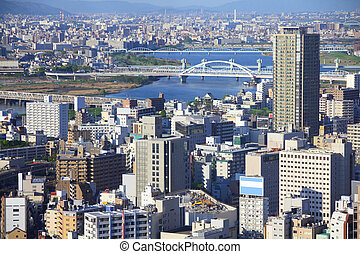 Osaka, Japan - skyline of famous city in the region Kansai....
