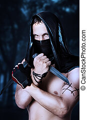 Man assassin with sexy torso in mask - Man assassin with...