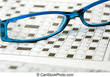Puzzle - spectacles on crossword number puzzle background