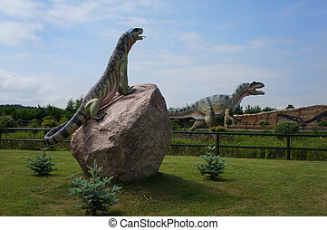 Allosaurus and The Komodo dragon. Models of dinosaurs in...