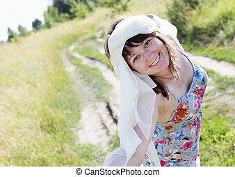 Happy Woman Walking the Meadow