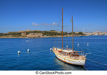 Valletta, Malta - Sailboat and the city of Valletta in...