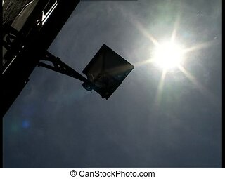 SUN and streetlamp - A shiny sun in a blue sky and an old...