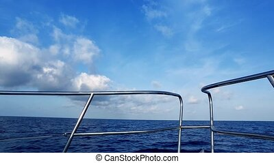 Boating in blue ocean sea view from boat bow deck...