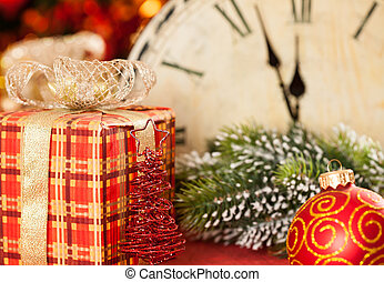 Christmas gift - Christmas decorations against vintage clock...