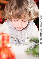 Child blowing out candles - Beautiful child blowing out...