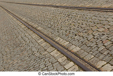 Cobbled street with tram rails in summer