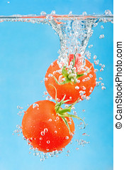 falling into the water tomatoes