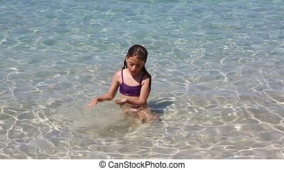 beautiful little girl playing beach - beautiful little girl...