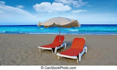 idyllic shore beach turquoise water hammock and parasol in...