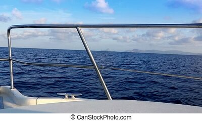 boat sailing in blue mediterranean sea on ibiza balearic...
