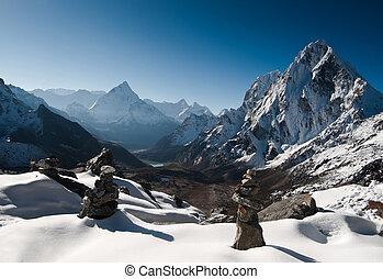 Cho La pass and stone stacks at daybreak in Himalayas....