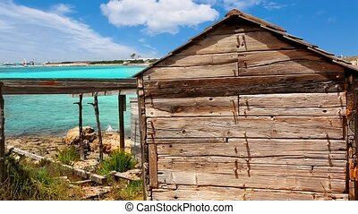 Formentera Illetes beach aged boat wooden grunge house...