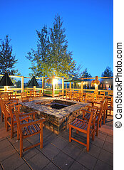 Many chairs around an outdoor fire pit - Chairs around a...