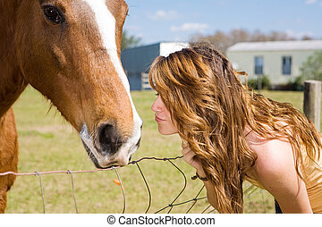 Kiss for Horse - Teen girl kisses her horse on the nose.