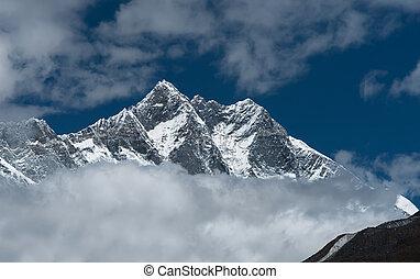 Lhotse, Lhotse shar peaks and cloudy sky in Himalaya. Hiking...
