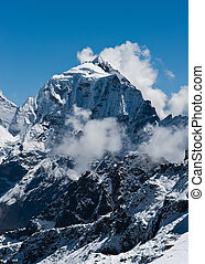 Taboche mountain peak and clouds viewed from Renjo pass In...