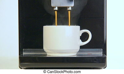 coffee maker pours coffee into a cup close-up