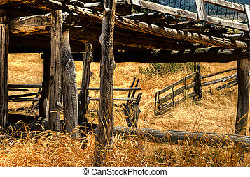 Corral gate - An open corral gate on a southwestern ranch,...