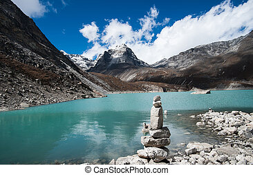 Harmony and balance: Pebble stack and Sacred Lake in...