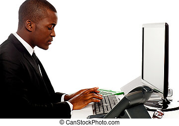 Side view male secretary typing on keyboard