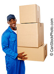 Young delivery guy holding stack of parcel boxes isolated...