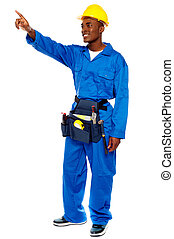 Young african male worker pointing at copy space