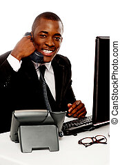 How can I help you - Cheerful young african talking on...