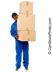 Delivery boy carrying heavy boxes - Full length portrait of...