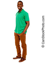 Casual young guy posing with hands in pocket isolated on...
