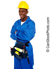 Smiling african worker posing with arms crossed