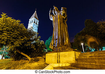 Gregory of Nin Statue and Bell Tower in Split at Night,...