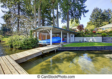 Pier with shed and boat and water lake view - Waterfront...