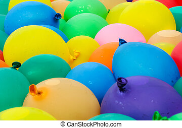 Water Balloons - Balloons of different colors filled with...