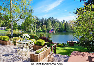 Beautiful deck near lake with spring landscape.