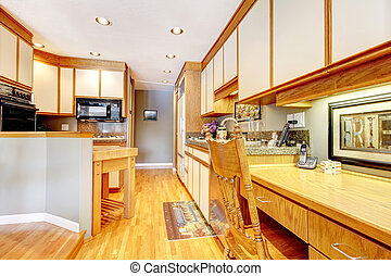 Kitchen interior with white and wood cabinets.