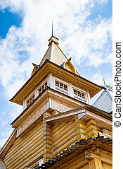 Wooden log house with blue sky above - Wooden log house with...