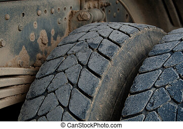 Dump Truck Tires - Closeup of large tires and suspension of...