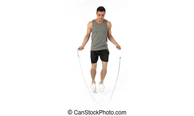 Man jumping with a skipping rope against a white background