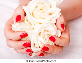 Closeup image of red manicure with flowers - close-up of...