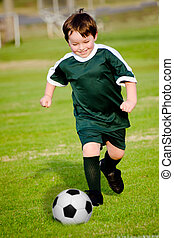 Young boy playing soccer