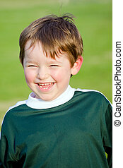 Smiling boy in soccer uniform