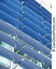 blue brise-soleil - Close-up view of a curtain wall with a...